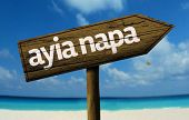 Ayia Napa wooden sign with a beach on background