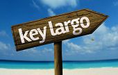 Key Largo - Florida, United States wooden sign with a beach on background