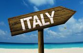Italy wooden sign with a beach on background