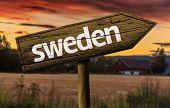 Sweden wooden sign in a rural background