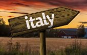 Italy wooden sign in a rural background