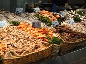 picture of avignon  - Fresh shrimp and calamari in the market of Les Halles Avignon France - JPG