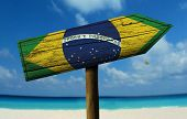 pic of bandeiras  - Brazil flag wooden sign with a beach on background  - JPG