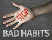 Educational and Creative composition with the message Stop Bad Habits on the blackboard