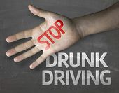 Educational and Creative composition with the message Stop Drunk Driving on the blackboard