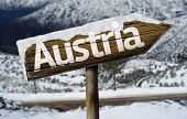 Austria wooden sign with a snow background