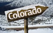 Colorado , USA , America wooden sign with a snow background