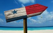 stock photo of bandeiras  - Panama wooden sign with a beach on background  - JPG