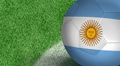 Amazing Soccer ball with Argentina flag isolated on field