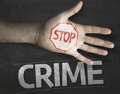 Educational and Creative composition with the message Stop Crime on the blackboard