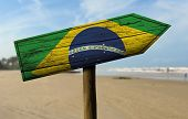 Brazil flag wooden sign with a beach on background - Latin America