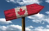 Canada flag wooden sign with a beautiful sky on background - North America