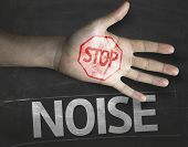 Educational and Creative composition with the message Stop Noise on the blackboard
