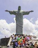 RIO DE JANEIRO, BRAZIL - NOV 03: Tourists on the Corcovado Hill on November 03, 2013 in Rio de Janeiro, Brazil. The monument is the best-known Brazilian image, famous all over the world.