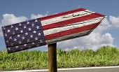 USA flag wooden sign on the road - North America