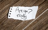 Are you ready written on the paper on a wood background