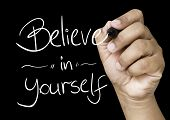 Believe in Yourself hand writing with a white mark on a transparent board