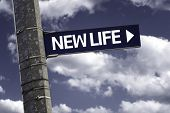 New Life creative sign with clouds as the background