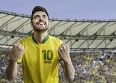 Brazilian man celebrates on the soccer stadium