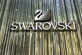 SYDNEY, AUSTRALIA - JANUARY 4: Swarovski logo on January 4, 2014 in Sydney, Australia. Swarovski is an Austrian producer of luxury cut lead glass (crystal).