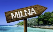 Milna on Brac island, Croatia wooden sign with a beach on background