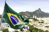 Brazilian waving flag on Rio de Janeiro, Brazil, South America