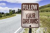 picture of follow-up  - Follow your dreams road sign on the road - JPG