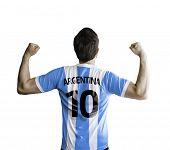 Argentine soccer player celebrates on white background