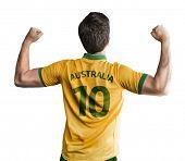 Australian soccer player celebrates on white background