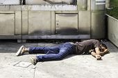 SAO PAULO, BRAZIL - CIRCA JAN 14: Unidentified Homeless sleeps on the street on Paulista Avenue. In downtown of Sao Paulo, there are too many homeless.