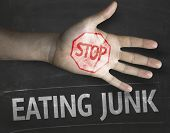 Educational and Creative composition with the message Stop Eating Junk on the blackboard