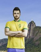 Brazilian soccer player looks serious in Rio de Janeiro, Brazil