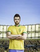 Brazilian soccer player looks serious on the stadium