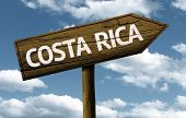 Costa Rica text wooden sign with a beautiful sky on background