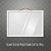 Vector white horizontal photo frame hanging on the wall.
