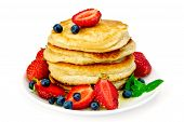 stock photo of dessert plate  - A stack of pancakes with strawberries - JPG