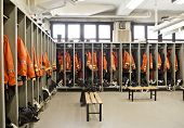picture of medevac  - Firefighter suits orange firestation interior with benches - JPG