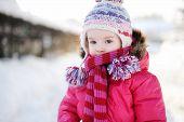 Little Girl Walking In A Purple Wintercoat