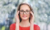 Portrait Of Young Beautiful Happy Girl In Glasses Outdoors, Nature, Youth, Student - Concept