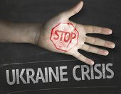 Educational and Creative composition with the message Stop Ukraine Crisis on the blackboard