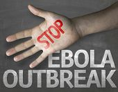 Educational and Creative composition with the message Stop Ebola Outbreak on the blackboard