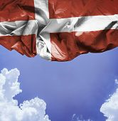 Denmark waving flag on a beautiful day