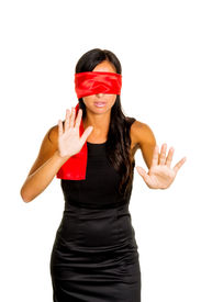 stock photo of groping  - a young woman with fastened eyes - JPG