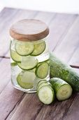 picture of refreshing  - A potrait of refreshing mineral water with ice and sliced cucumber - JPG