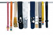 image of obsidian  - Row of woman many belts on hanger  - JPG