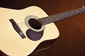 Acoustic Guitar Isolated On Gold