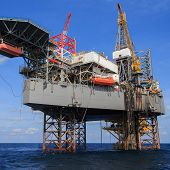 stock photo of drilling platform  - Offshore Jack Up Drilling Rig Over The Production Platform in The Middle of The Sea - JPG