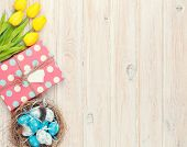 foto of nesting box  - Easter background with blue and white eggs in nest - JPG