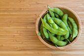 foto of soybeans  - Japanese green soybeans on the wooden table - JPG
