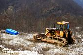 pic of bulldozer  - Abandonned bulldozer on a site - JPG